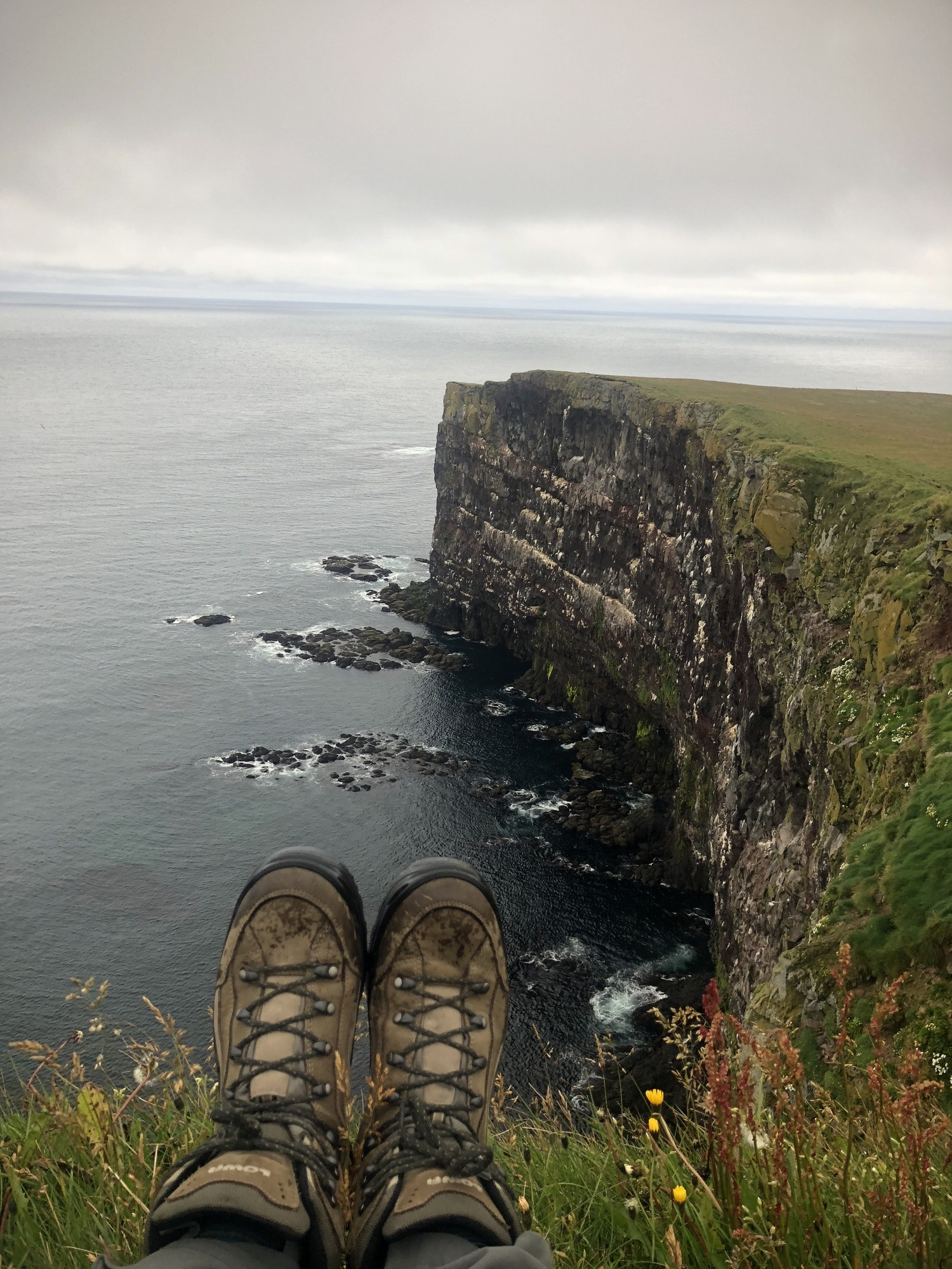 Hiking boots on edge of cliff
